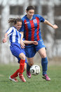 Girls fighting for ball during soccer game Royalty Free Stock Photo