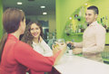 Girls flirting with barman Royalty Free Stock Photo
