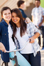 Girls friends hugging two beautiful teen outdoors Royalty Free Stock Photos