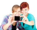 Girls friends taking picture of themselves Stock Photo
