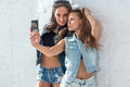 Girls friends taking selfie picture. Two beautiful Royalty Free Stock Photo