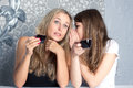 Girls girlfriends fissile secrets over coffee Royalty Free Stock Photo