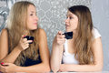 Girls girlfriends fissile secrets over coffee two Royalty Free Stock Image
