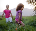 Girls in the grass Royalty Free Stock Photo