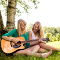 Girls and the guitar Royalty Free Stock Photos