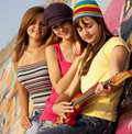 Girls with guitar and graffiti wall Royalty Free Stock Photography