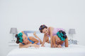Girls in hair rollers having fun in bed Royalty Free Stock Photo