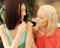 Girls having coffee break and eating ice cream Royalty Free Stock Photo