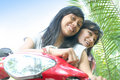 Girls having fun on bike Stock Photos