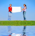 Girls holding blank sheet Stock Image