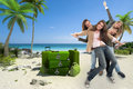 Girls on holiday a group of happy celebrating women in an exotic travel background Royalty Free Stock Image