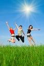 Girls jump meadow Стоковые Изображения