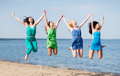 Girls jumping on the beach summer holidays and vacation Stock Photo