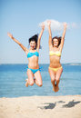 Girls jumping on the beach summer holidays and vacation Royalty Free Stock Photography