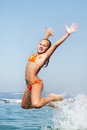 Girls jumping out of the water on sea at summer Stock Photos
