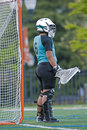 Girls lacrosse goalie waiting for action Royalty Free Stock Photo