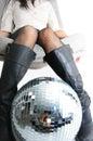 Girls legs and glitterball Royalty Free Stock Photo