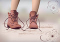 Girls legs in laced boots on the path Stock Images