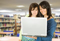 Girls in the library with a laptop Royalty Free Stock Photos