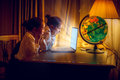 Girls looking with amazement at laptop at night Royalty Free Stock Photo