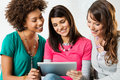 Girls Looking At Digital Tablet Royalty Free Stock Image