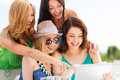 Girls looking at tablet pc in cafe summer holidays vacation internet and technology Royalty Free Stock Photography