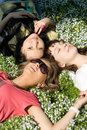 Girls lying on grass Stock Photography