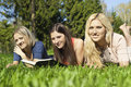 Girls on the nature of reading a book Stock Image