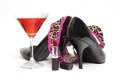 Girls night out concept with shoes drink and lipstick Stock Photos