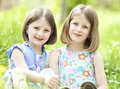 Girls in the park happy children lying on green grass outdoors grass Stock Photography