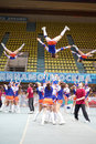 Girls - participants of cheerleaders team Leader perform Royalty Free Stock Photo