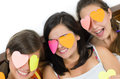 Girls party three with eyes covered by heart shaped paper sticker Stock Photo