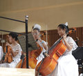 Girls play cello songbai middle school students of amoy city performances report orchestral music the picture shows Royalty Free Stock Photos