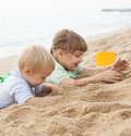 Girls playing on the beach two beautiful play Royalty Free Stock Image