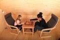 Girls playing draughts Royalty Free Stock Photo