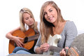 Girls playing the guitar together Royalty Free Stock Photography