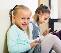 Girls playing with smartphones Royalty Free Stock Photo