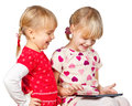 Girls playing with a tablet computer Stock Images