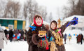 Girls plays during shrovetide at russia two happy Royalty Free Stock Photo