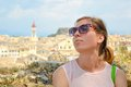 Girls portrait with Kerkyra town panorama in background Royalty Free Stock Photo