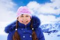 Girls portrait on snow day close of happy years old caucasian girl in blue standing outside in winter Royalty Free Stock Photo