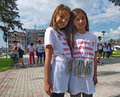 Girls posing at the start of a fun run before usually is part marathon race aim is to popularize healthy Stock Photos