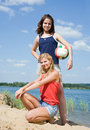 Girls posing with volleyball Royalty Free Stock Photo