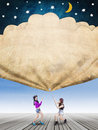 Girls pull a banner with stars and moon Royalty Free Stock Photo
