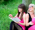 Girls reading the book Stock Photography