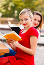 Girls reading books beautiful student in the university campus studying for exams Royalty Free Stock Photo