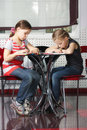 Girls reading books in cafe Royalty Free Stock Images