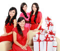 Girls in red with many gift boxes Stock Photography