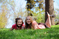 Girls Resting on Grass Royalty Free Stock Photos