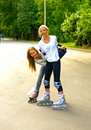 Girls on rollers Royalty Free Stock Photo